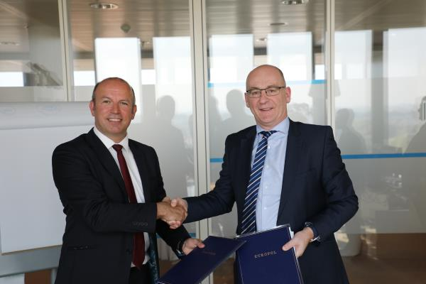 BT's Kevin Brown (left) and Europol's Steven Wilson sign an agreement which sees both parties share information relating to cyber threats and attacks.