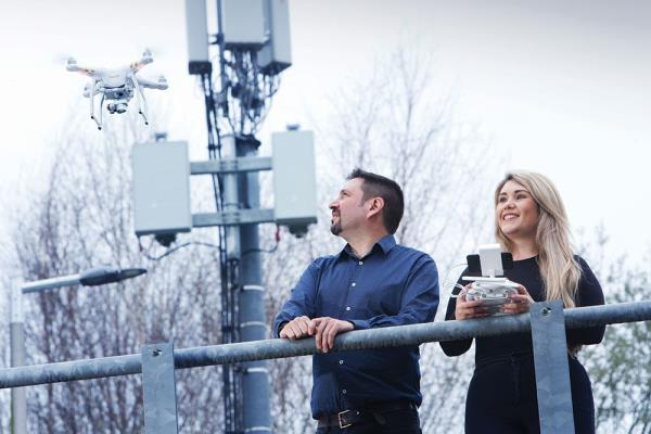 A week after winning the largest amount of 5G spectrum, Vodafone claimed a milestone in UK telecoms with the first test of 3.4GHz frequencies. Jade Knight, head of network deployment for the South, and Peter Rodriquez, head of 5G Delivery, are seen here using a drone to check on the status of the 5G mobile site in Newbury without having to turn the service off.
