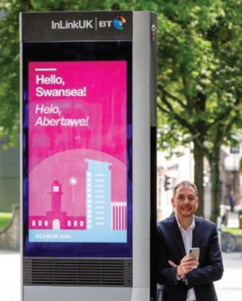 Swansea Council leader Rob Stewart with one of the city's new InLink kiosks. They will support both Welsh and English, with the main screens showcasing dual language community information at launch and the interactive tablet to follow shortly.